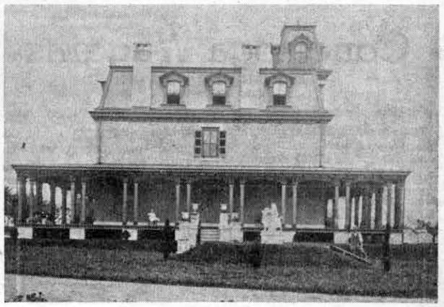 The left side of this picture shows the back view of old Louella House, the front being marked by the stately cupola which still tops the building on its Lancaster avenue side. In the 1860's this cupola commanded a far flung view over what were then farmlands in all directions. The two wings, to the east and west, were added at a later date, the eastern wing taking the place of a large greenhouse.